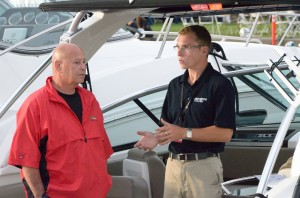 Grant Haugen talks with a customer at the Boat Show