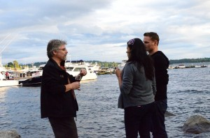 Guests of Kirkland Uncorked chat by with a Kirkland Marina backdrop