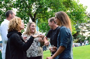 Guests share a laugh at Kirkland Uncorked